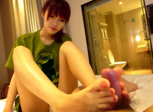 asian virgin female give a footjob and..